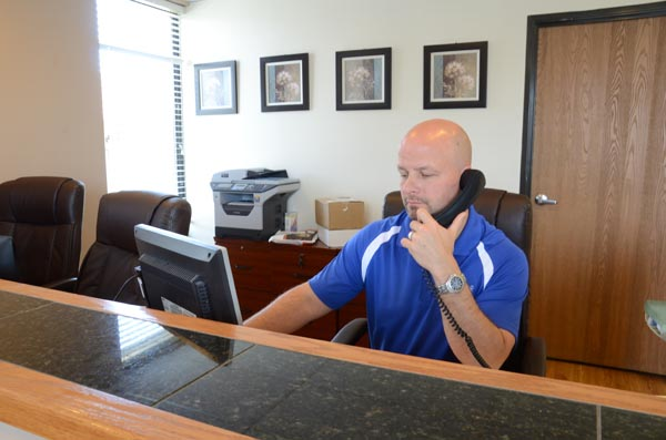 Dr. Madorno taking a call at the reception desk